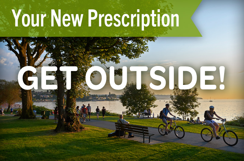 Your New Prescription: get outside people biking around a lake at sunset