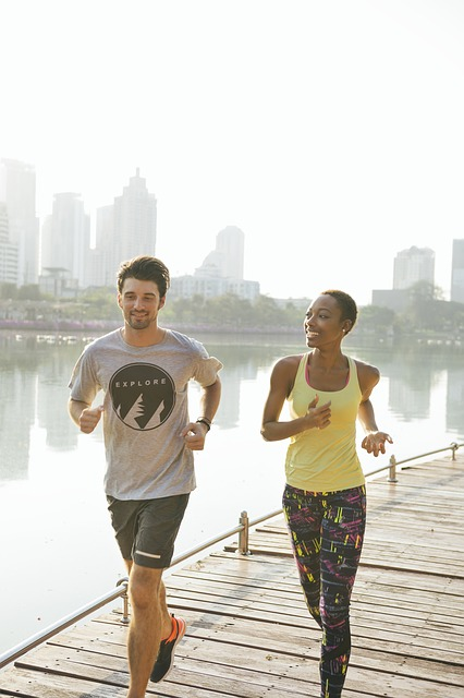 Man and woman smiling and running together on the dock