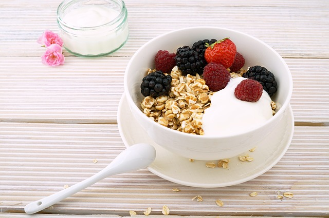 bowl of filling oatmeal with berries and yogurt