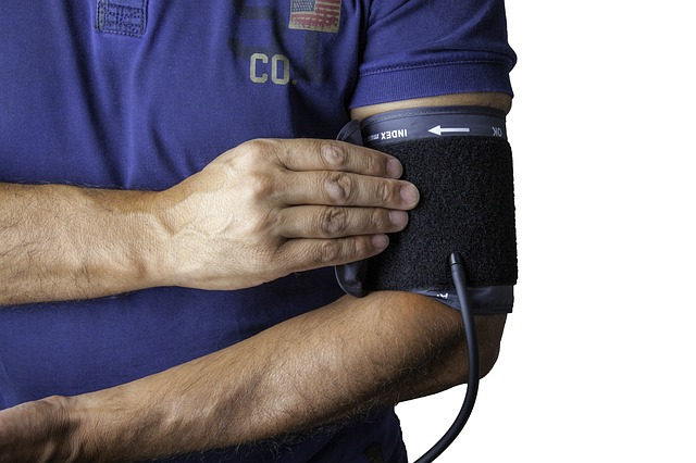 man with blood pressure cuff on