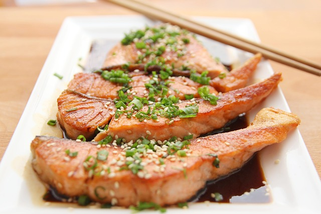 salmon with teriyaki sauce green onions and sesame