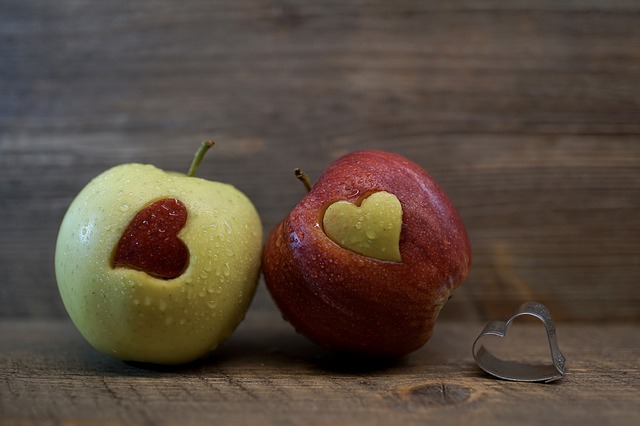 apples with hearts cut out of them