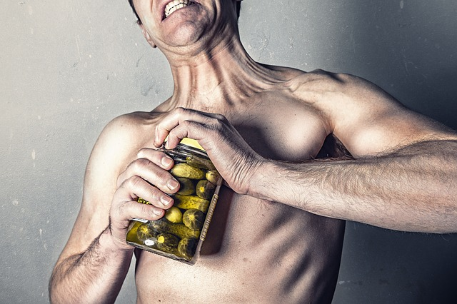 preserving muscle mass man opening pickles